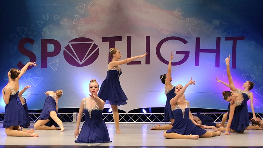 group of girls dancing on stage
